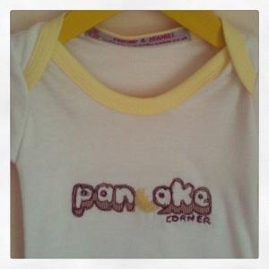 handmade British baby onesie pancake corner personalised corporate custom company name